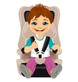 little boy strapped to a car seat vector image vector image