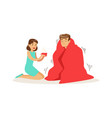 woman helping a frozen man wrapped in red a vector image vector image