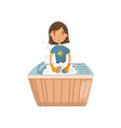 young brunette woman in casual clothing washing vector image