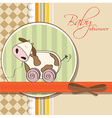 Baby shower card with cute cow toy vector image