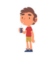 boy drinking soda drink from paper cup through vector image