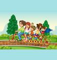 family riding bike in park vector image