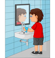 cute little boy washing his hands in the bathroom vector image