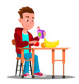 child at the dinner table with fruit and juice in vector image