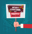 santa hand hold merry christmas and happy new year vector image vector image