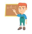 caucasian schoolboy writing on the blackboard vector image vector image