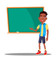 little boy answers at the blackboard in the vector image vector image