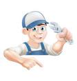 cartoon plumber peeking over sign vector image vector image