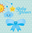 blue crib mobile toy and bow decoration baby vector image