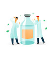 two medical scientists and a bottle of medication vector image