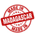made in madagascar red grunge round stamp vector image