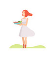 young woman holding a bowl of vegetables and vector image vector image