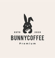 bunny coffee hipster vintage logo icon vector image