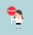 businesswoman showing stop road sign vector image