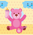 pink toy bear with feeding bottle rattle toy vector image