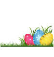 hand painted easter eggs on grass vector image