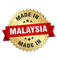 made in malaysia gold badge with red ribbon vector image vector image