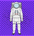 a man astronaut in a suit is isolated on a pop art vector image