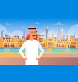 arab man walking modern city building cityscape vector image vector image