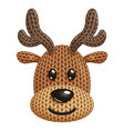 a funny knitted reindeer toy head on white vector image