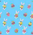 easter bunny holding a big paschal egg funny vector image
