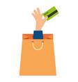 shopping bag with hand and credit card vector image