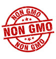 non gmo round red grunge stamp vector image vector image