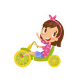 lovely little girl riding tricycle cute cartoon vector image vector image