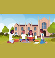 african students group sitting on grass at campus vector image