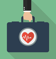 Hand holding first aid kit vector image