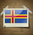 Flags Aland at frame on wooden texture vector image