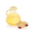 glass bottle of peanut oil and heap of nuts vector image vector image