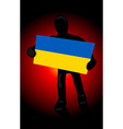 silhouette of a man with the flag of Ukraine and vector image vector image