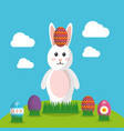 easter bunny with decorated egg on head vector image