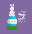 happy easter rabbit sitting on big egg vector image