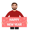man holds poster happy new year on a white vector image