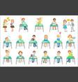 children sitting at school desks in class vector image