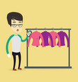 man shocked by price tag in clothing store vector image vector image