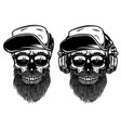 human skulls with sunglases baseball cap and vector image vector image