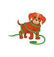 cute puppy tangled in green gift-wrap ribbon vector image