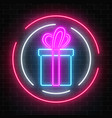 neon gift with ribbon glowing sign in circle vector image vector image