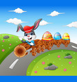 happy easter bunny driving a timber train carrying vector image
