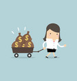 businesswoman walking with a trolley full of money vector image vector image