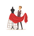 male dressmaker sewing red dress on a dressmakers vector image vector image