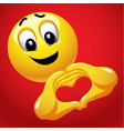 smiley with heart shape hand sign cute smiley vector image