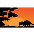 At sunset dinosaur triceratops scenery vector image vector image