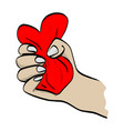 hand squeezing red heart shape vector image vector image