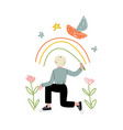 cute blond boy drawing rainbow on wall with color vector image vector image