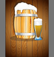 open wooden barrel and a glass of beer vector image