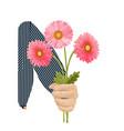 pink gerbera in hand vector image vector image
